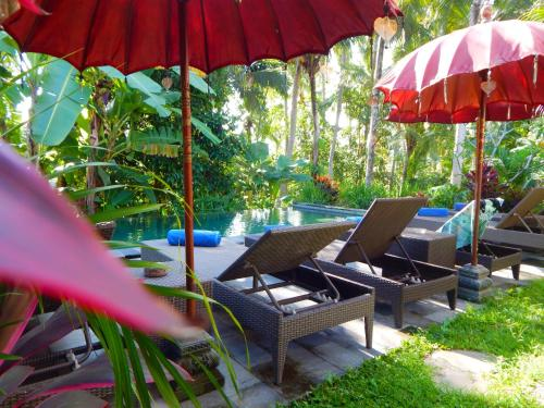 The swimming pool at or near Amaya Cottage Ubud