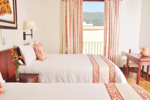 A bed or beds in a room at Mision Jalpan