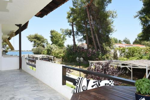 A balcony or terrace at Haus Platanos Apartments & Bungalows by the Sea
