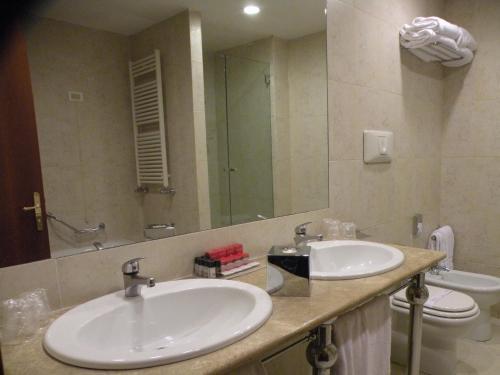 A bathroom at Ramada by Wyndham Naples