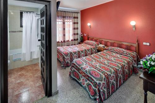A bed or beds in a room at Hotel Mora