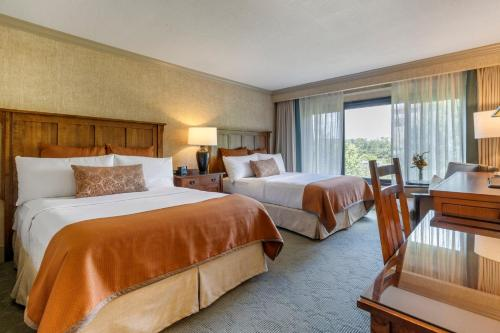 A bed or beds in a room at The Omni Grove Park Inn - Asheville