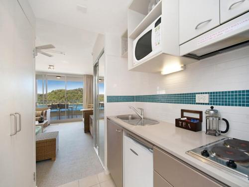 A kitchen or kitchenette at Ocean Panorama - 1 Bedroom Oceanview Apt