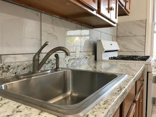 A kitchen or kitchenette at Ozone Pk Adria Apartment