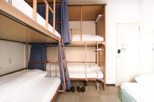 A bunk bed or bunk beds in a room at Sakura Hotel Jimbocho