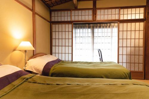 Tempat tidur dalam kamar di Hotel Hanakoyado