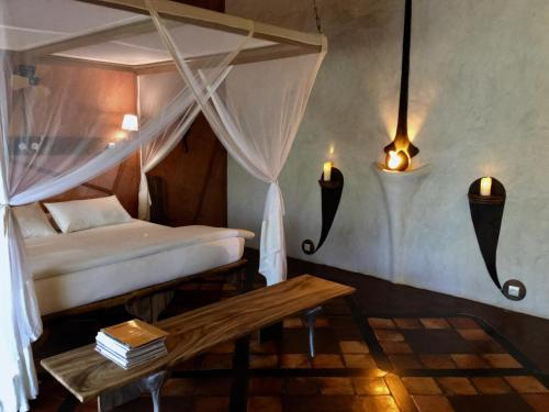 A bed or beds in a room at Bakuba Hotel