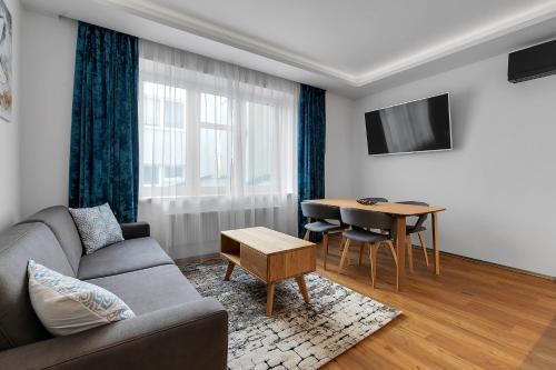 Posezení v ubytování Nový designový apartmán s klimatizací