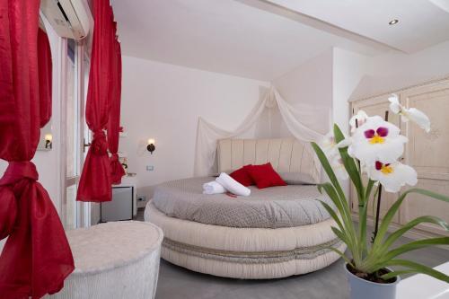 Letto o letti in una camera di Hotel Villa dei Gerani
