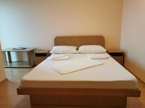 A bed or beds in a room at Vila Alexa