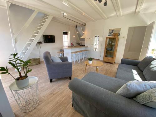Ein Sitzbereich in der Unterkunft Apartment Schelpenplein