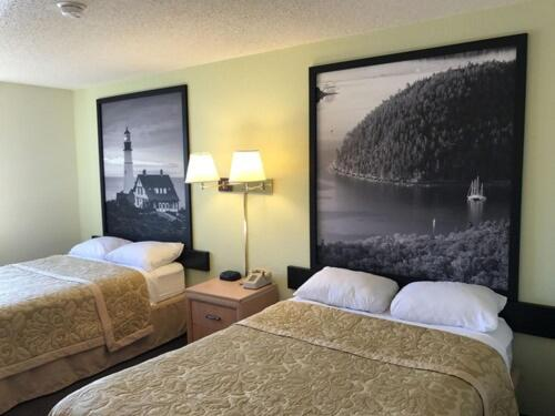 A bed or beds in a room at Super 8 by Wyndham Augusta