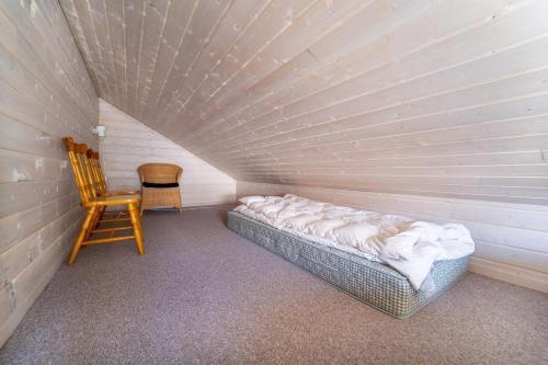 Ein Bett oder Betten in einem Zimmer der Unterkunft Fidjeland near ski trekk