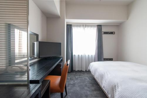 A television and/or entertainment center at Hotel Vista Ebina