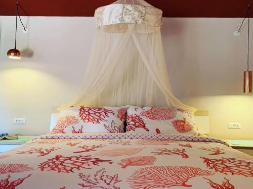 A bed or beds in a room at Villa Mihaela Apartments in Porec