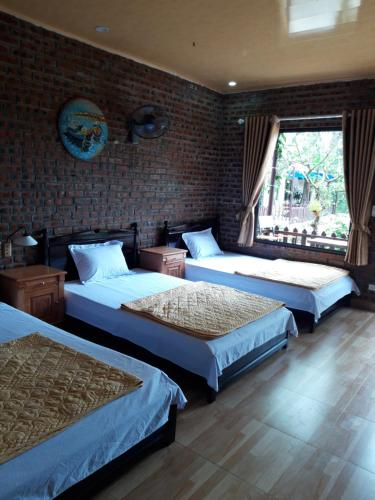 A bed or beds in a room at Green Homestay