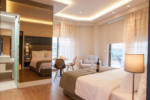 A bed or beds in a room at Athens Platinum Rooms and Suites