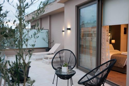 A balcony or terrace at Athens Platinum Rooms and Suites
