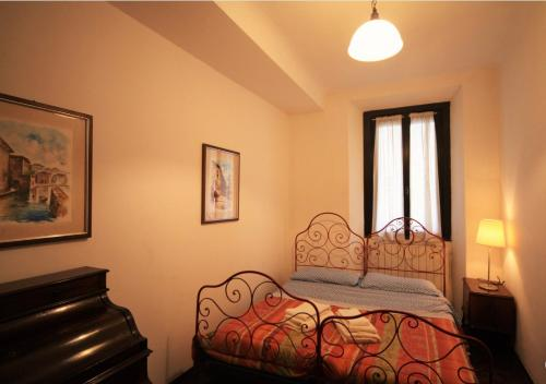 A bed or beds in a room at Antica Corte Milanese