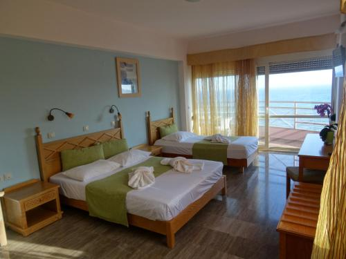 A bed or beds in a room at Thalassa House Apartments