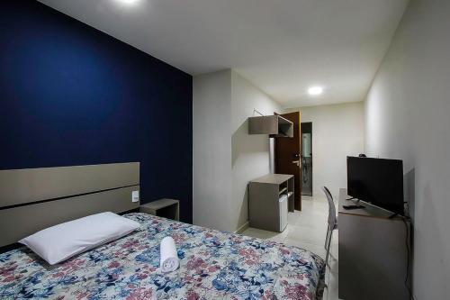 A bed or beds in a room at No centro de Brasília com vista para área verde