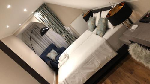 Ein Bett oder Betten in einem Zimmer der Unterkunft Hotel Allegra