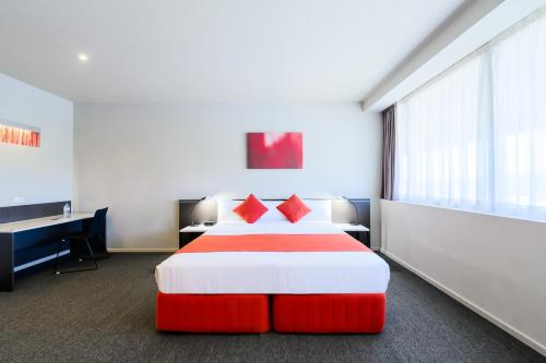 A bed or beds in a room at Abode Woden