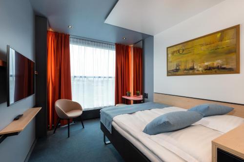 Кровать или кровати в номере Art Hotel Pallas by Tartuhotels