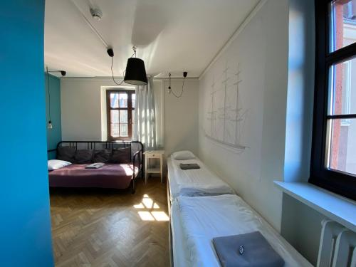 A bed or beds in a room at Grand Hostel