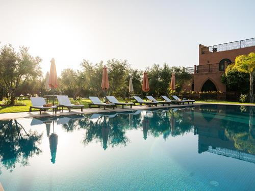 The swimming pool at or near Suite Royale - Emeraude