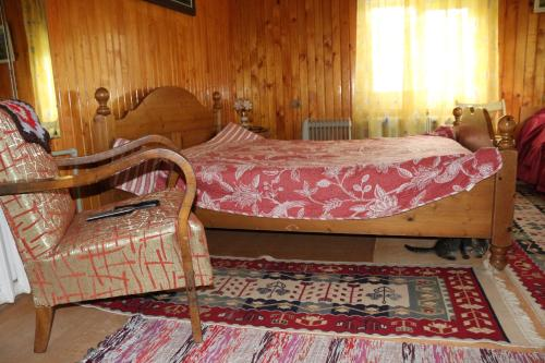 A bed or beds in a room at Sadyba Lukacha