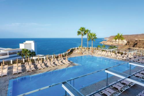A view of the pool at Riu Vistamar - All Inclusive or nearby