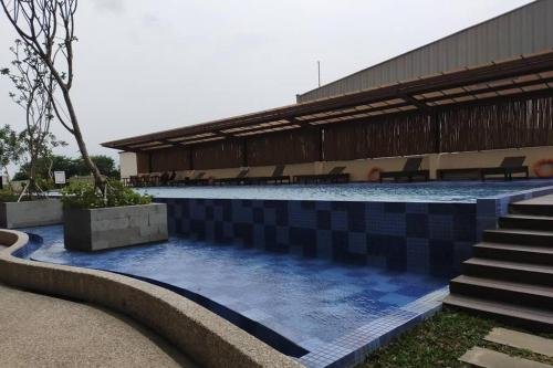 The swimming pool at or close to Azalea Suites Cikarang - By Urban Style Collections