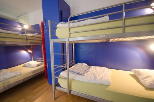 A bunk bed or bunk beds in a room at H2O Hostel