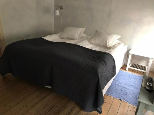 A bed or beds in a room at Brunius Bed and Breakfast