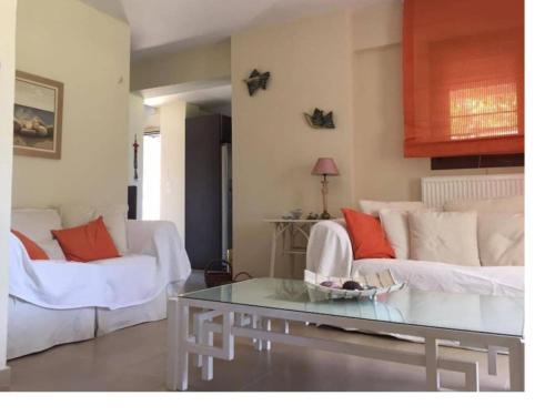 Ένα ή περισσότερα κρεβάτια σε δωμάτιο στο Villa by the Sea