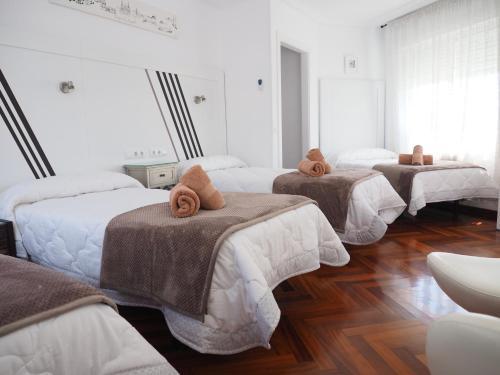 A bed or beds in a room at PR Una Estrella Dorada