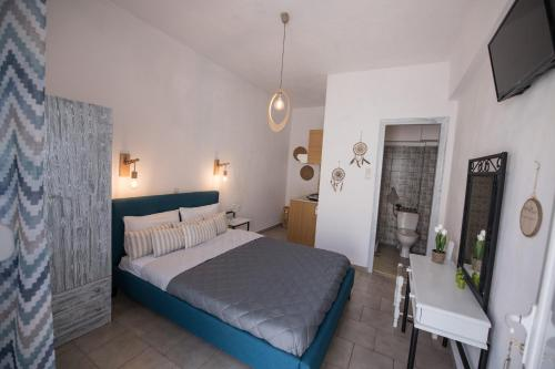 Ένα ή περισσότερα κρεβάτια σε δωμάτιο στο Βυθός