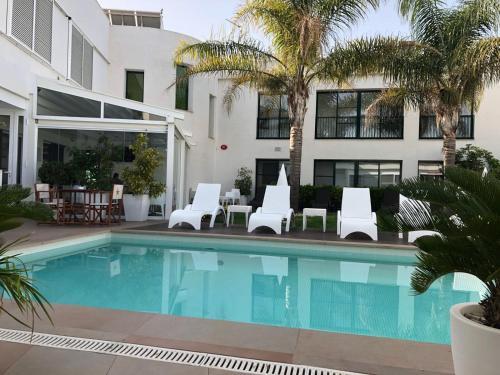 The swimming pool at or near Hotel L'Algadir del Delta