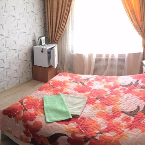 A bed or beds in a room at Hotel Almaz