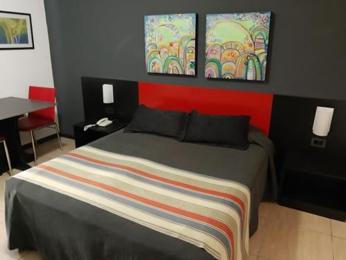 A bed or beds in a room at Apart Hotel Alvear