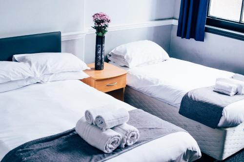 A bed or beds in a room at Bridgewood House
