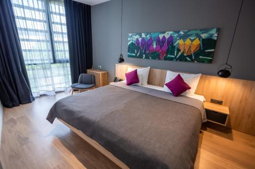 A bed or beds in a room at Hotel Academia