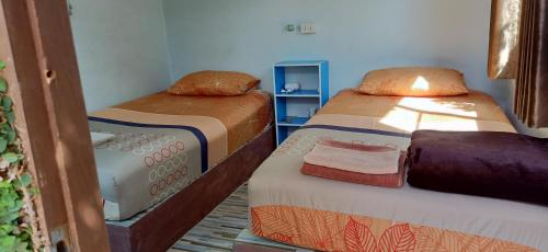 A bed or beds in a room at Canaan Guesthouse