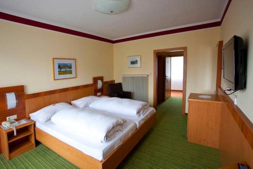 Ein Bett oder Betten in einem Zimmer der Unterkunft Gasthof Böhm