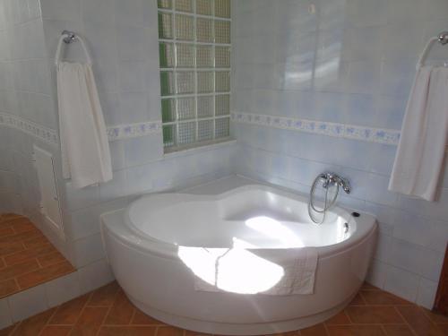 Un baño de Apartamentos Turísticos Cumbres Verdes