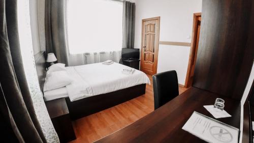 Кровать или кровати в номере Вилла Татьяна Верхнеозерная