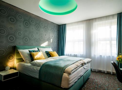 A bed or beds in a room at Hotel Planet Prague