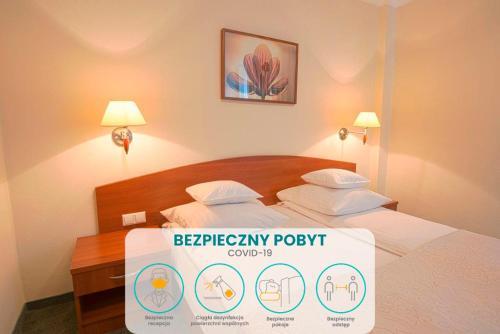 Un ou plusieurs lits dans un hébergement de l'établissement Arena Hotel Spa & Wellness