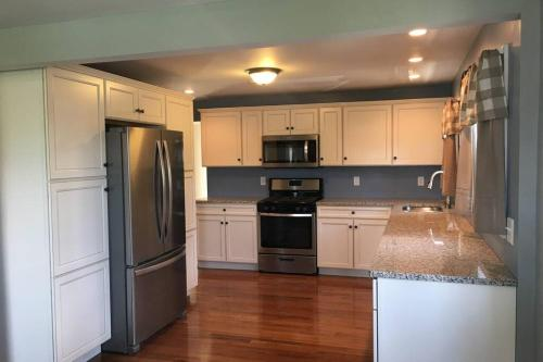 A kitchen or kitchenette at Watkins Glen ranch with lake view